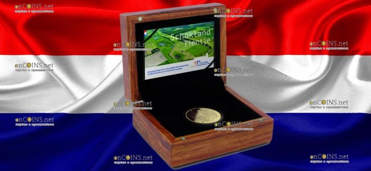 Нидерланды монета 10 евро Схокланд, подарочная упаковка