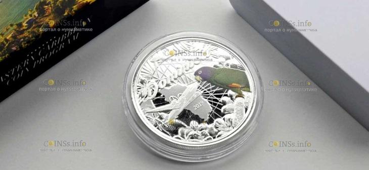 Доминика выпускает серию монет попугай Сиссеру